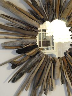 DIY Driftwood Starburst Mirror Tutorial.  All things driftwood.