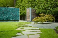 Gabion fence with recycled glass rocks