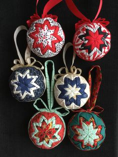 "my own projects: no-sew quilted christmas ornaments. made with 2.5"" styrofoam balls, 3 different fabrics each (2.5"" squares, 8pieces for the center, 16 for each outer layer) some ribbon and 130-170 straight-pins each (you can skimp on pins a bit if you pin the outer points of 2 adjacent triangles with 1 pin instead of pinning separately) made according to this video by AngiesBitsAndPieces https://youtube.com/watch?v=00fIGg7MNJ8"