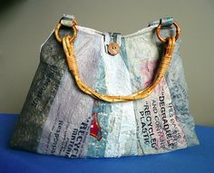 Recycled plastic bag purse.  Good idea for unused purse handles.