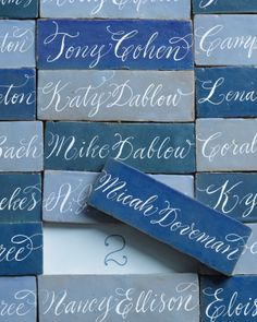 Calligraphed Moroccan ceramic tiles make beautiful escort cards that are sure to become keepsakes.