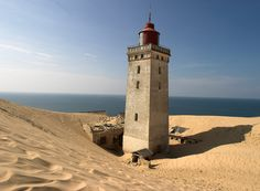 Old lighthouse at Rubjerg Knude by Jørgen Mikkelsen. Reminds me of the Chinese or Japanese tale of man sentenced to keeping sand from house.