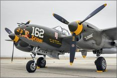 On the ramp awaiting the start of the Planes of Fame airshow. Judging by the weather, this could've been taken in England during WWII. Ww2 Aircraft, Fighter Aircraft, Military Aircraft, Fighter Jets, Image Avion, Lockheed P 38 Lightning, Ww2 Planes, Nose Art, Wwii