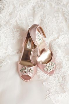 Blush pink satin d'Orsay heels with a rhinestone toe detail from Badgley Mischka.