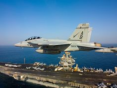 F/A-18 Super Hornets fly over USS Enterprise (CVN 65). by Official U.S. Navy Imagery