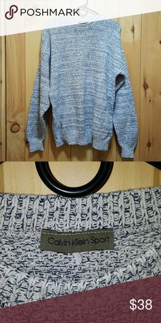 Calvin Klein oversized sweater This sweater goes perfect with leggings! It's big for me, but it's supposed to fit big. It's a size large but the size tag is worn from wash. The sweater is in excellent condition itself though and super comfy! Calvin Klein Collection Sweaters Crew & Scoop Necks
