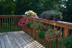 Decorate your deck balusters with beautiful potted plants! No tools required, just slip the flower pot holder on and off whenever you'd like!
