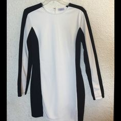 NWOT. TOBI black and cream color block dress. This TOBI dress has never been worn! Made of 95% Polyester and 5% Elastane. Size large however it is closer to a medium. It is closer to a size 8. TOBI Dresses Midi