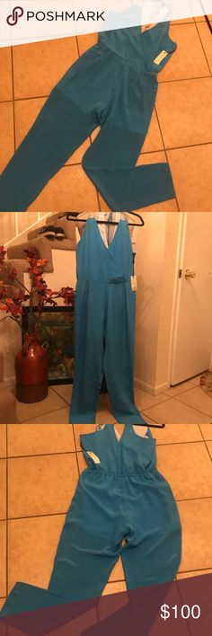 "Townsen Hawi Silk Woman's Jumpsuit Marine Blue S Silk Jumpsuit Marine Blue original price $120 New With Tags Style# SU15-R26HA Two Front Pockets Back Elastic Waist Measurements 18"" From Armpit to Armpit 28"" without stretching will stretch up to 30"" Inseam Length 28"" TOWNSEN Pants Jumpsuits & Rompers"