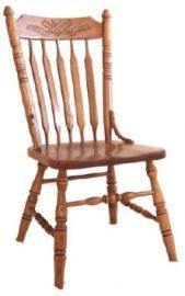 Have you ever taken store-bought cookies, served them on your own plate, and passed them off as homemade? Employing a similar ruse, Press Back Chairs have been mimicking a hand-carved look since the late 1800's. By pressing a steel die stamp into steam-bent wood, furniture makers could mass-produce these charming dining chairs. Consumers loved having the Queen Anne style carvings at a price they could afford, and the charming country chairs are still popular today.
