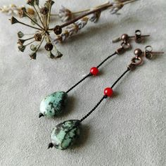 earrings with African turquoise, coral and silk on copper.
