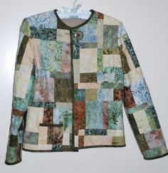I haven't had a lot of time to sew lately, but I thought I'd post some pictures of a pieced jacket that I completed. This one is made from a quilt kit Quilted Sweatshirt Jacket, Quilted Jacket, Quilted Clothes, Jellyroll Quilts, Jacket Pattern, Keepsake Quilting, Wearable Art, Sweatshirts, Fabrics
