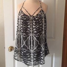 NWT Express Dressy Tank New with tags. Dressy black and white tank. Looks great paired with a cardigan or blazer! Express Tops Tank Tops