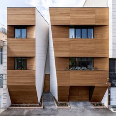 Afsharian's House by ReNa Design has a huge vertical slice in its facade, Iran.