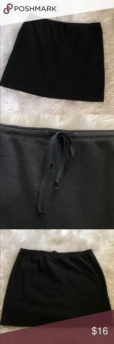 Simple Black Cotton Skirt Cute and simple skirt to throw on. Drawstring waistline, 14.5 in length. Stretches to shape. 95%cotton. 5%spandex. Express Skirts Mini