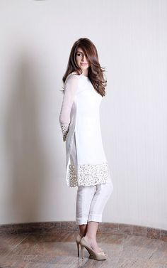 Natasha Kamal: hand finished cutowrk dress $275 Contemporary and classic. The hand finished cutowrk detail on the cuffs and daman enhance this pure white chiffon and silk ensemble. Raw silk cigarette pants add the finishing touch, creating a timeless piece.                                                                                                                                                      More