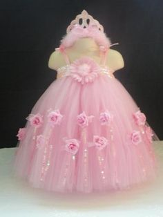 Just thought id share what we added to our boutique.  The pink one is a flower girl tutu dress. With over 150 yards of tulle and tons of decorations....
