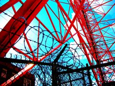 Wire - Jon Lander - copyright 2014 - chain link, concertina wire and TV broadcast tower - abstract photography