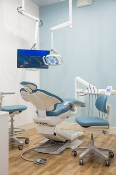 Blue dental chair upholstery and coordinating wall color creates a calming dental office design