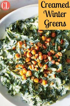 Two beloved dark leafy greens, spinach and lacinato kale, combine to bring deep, earthy flavor to this updated take on classic creamed spinach. We include a crunchy, oven-crisped chickpea and almond topping that takes this side dish from everyday to special occasion. | Cooking Light