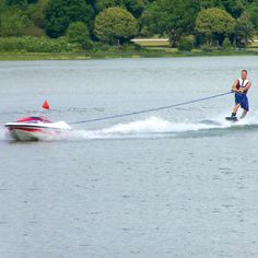 The Skier Controlled Tow Boat - Hammacher Schlemmer - This is the unmanned water skiing boat that's controlled entirely by the skier.