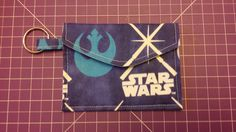 Pattern designed by AiviloCharlotte Designs. Glow In The Dark Lightsabers Coin Purse/Pouch Wallet Pouch, Wallet, Coin Purses, The Darkest, Pattern Design, Coins, Glow, Handmade, Coin Wallet