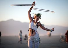 Ring Ring       Hooper Kaytibunny Roberts performs an impromptu sunrise dance at Burning Man 2012.      Read more: http://www.rollingstone.com/culture/pictures/burning-man-2012-20120905/hoops-0192219#ixzz26Cy6oG7H
