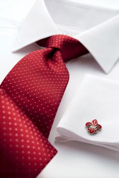 Red and white pin dot woven tie.