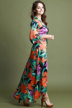 427a6fb851 This beautiful wrap dress features vibrant floral print design, surplice  neckline, quarter-length kimono sleeves, self-tie waist sash, and maxi  length hem.