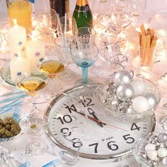 Plan an Easy New Year's Eve Cocktail Party    An effervescent party with a sophisticated silver theme is the perfect way to make the coming year feel exciting and special. Prepare well, and then let the magic take over.    A silver clock on the table is a fun way to make sure everyone is set for midnight.