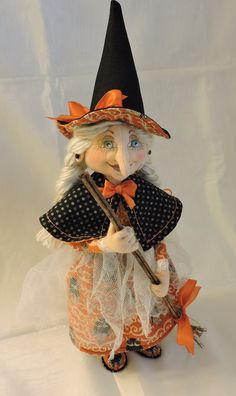10+ inches...with hat about 14 inches. Terese Cato patterns used to create this doll.