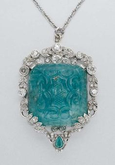 Carved emerald and diamond pendant-brooch with chain, circa 1905