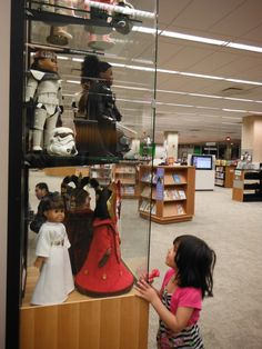 A little girl checking out my dolls at the Skokie Public Library.