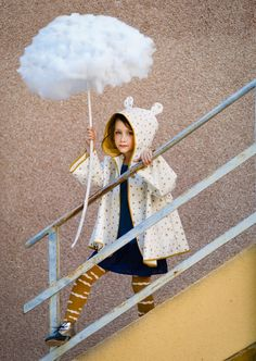 Babiekins editorial. Raincoat: Nobodinoz, Dress: Yporqué, Tights: Bobo Choses, Shoes: Clotaire