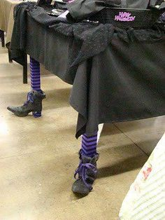 "Halloween witchy table legs! ( Just an Idea for Halloweeen ) maybe you can find some old shoes that look like this at the Thrift Store.......don't forget the Purple Socks and if they don't have black stripes makes Mom will let you use a Magic Marker ""outside on the sidewalk"": < )"