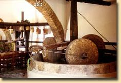 Fundana Villas Mansion Our olive press was used for the last time in Twenty years later it was cleaned and maintained so as to become a part of our small agrarian museum Hillside Village, Corfu Town, Olive Press, Cypress Trees, Peace And Harmony, Good House, Villas, Restoration, Hotels