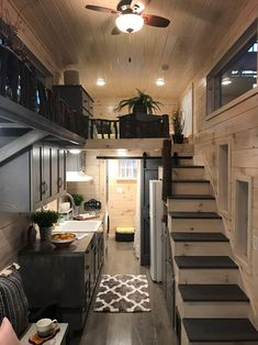 Dandelion Tiny House Built by Incredible Tiny Homes This is the Dandelion Tiny House on Wheels by Incredible Tiny Homes. It features a wood clad exterior siding, lots of windows, exterior storage, and it sits on a sturdy triple-axle trailer. Tiny Loft, Tiny House Loft, Best Tiny House, Building A Tiny House, Modern Tiny House, Tiny House Living, Tiny House Plans, Tiny House Design, Tiny House On Wheels