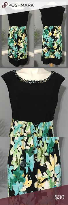 """Perceptions New York Empire Waist Floral Dress This Perceptions New York Dress has a printed ruffled neckline and empire waist with pretty floral and 3.5"""" black block at hem...it's stretchy and so comfortable but to big for me, there are a few strings on ruffled area of shoulders in one little section(pic 8) Size 16 it measures about 19.5-20"""" across chest and 37"""" in length...notice last pic for idea of empire waist it measures 13.5"""" from shoulder to waist...offers welcome bundle to save more…"""
