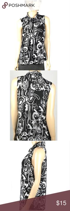 Serenade NY Black & White Paisley Print Blouse Serenade NY Black & White Paisley Print Blouse   Sleeveless blouse is in very good condition. 90% polyester 10% spandex.  Size large.  Chest measures approximately 21 inches across from armpit to armpit.  Approximately 24 inches long.#148🌺 Serenade New York Tops
