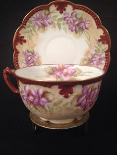 Beautiful A&K Limoges hand painted cup and saucer in excellent condition with no cracks, chips, or crazing. � The cup measures 3 3/8 in diameter without the handle and is 2 tall. The saucer measures