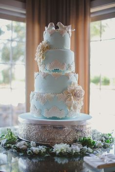 Blue wedding cake atop an Ornate Silver Cake Stand #CaptivatingCakeCreations