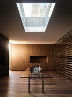 Minimal Luxury // modern wine cellar with a wood statement wall paired with percision and detail.