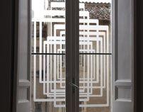Studio and home in Rome, screening pattern, adhesive opaline film. Mara Celani design in a Studio home in Rome.