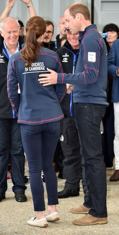 Affectionate: A dressed-down Prince William places his hand on his wife's back as they cha...