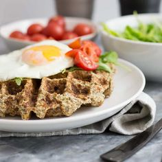 These simple low carb savory cauliflower waffles are going to become your favorite breakfast recipe! Paleo, whole30, vegetarian and low carb! So simple and filling! #paleo #whole30 #waffles #breakfast | https://bitesofwellness.com