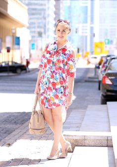 Fashion and Beauty Assistant Alexandra wears a cutout floral shirtdress from ASOS paired with nude accessories.