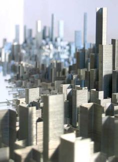 STAPLE Skyline - By Peter Root:  Like a talented tilt-shift photographer, this artist also captures his subjects up close to convey a sense of depth and size – one would almost believe this staple city could be a real skyline somewhere.