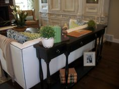 Table like this behind my couch.