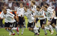 Relief: Germany celebrate their victory on home soil...