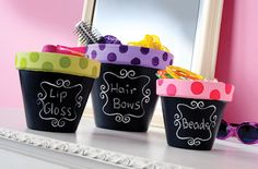 Clay Pots Use regular terra cotta pots for storage by painting them with chalkboard on the base and pretty colors on top.